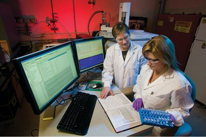 Assay Development Services - Two Scientists Working In the Lab